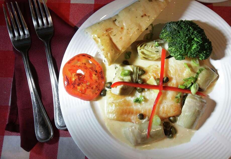 Tolentino's Italian Kitchen dish of Flounder Picatta in a white wine caper and artichoke sauce, April 25, 2012.  Bob Owen Photo: Bob Owen, San Antonio Express-News / © 2012 San Antonio Express-News