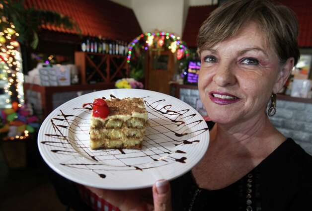 Vickie Tolentino, coowner of Tolentino's Italian Kitchen,  holds a serving of Tiramisu.  April 25, 2012.  Bob Owen Photo: Bob Owen, San Antonio Express-News / © 2012 San Antonio Express-News
