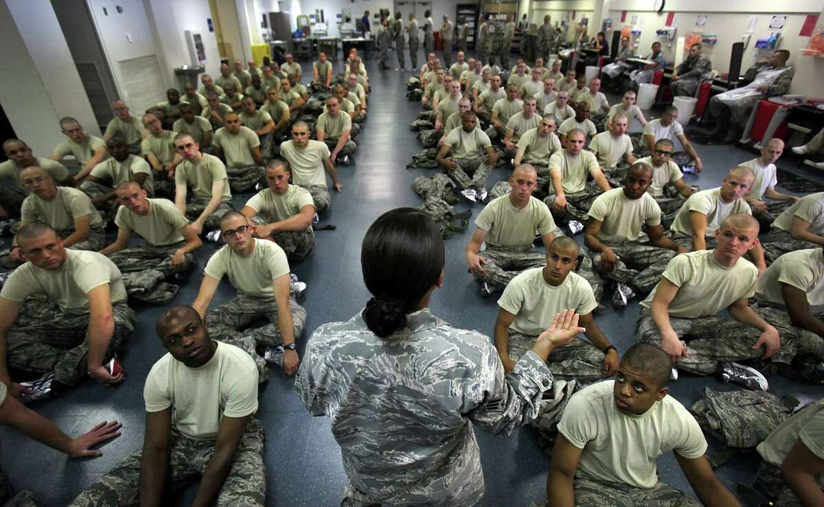 New trainees listen to instructions at Joint Base San Antonio-Lackland. Men who are victims of unwanted sexual contact are less likely to report it than women.