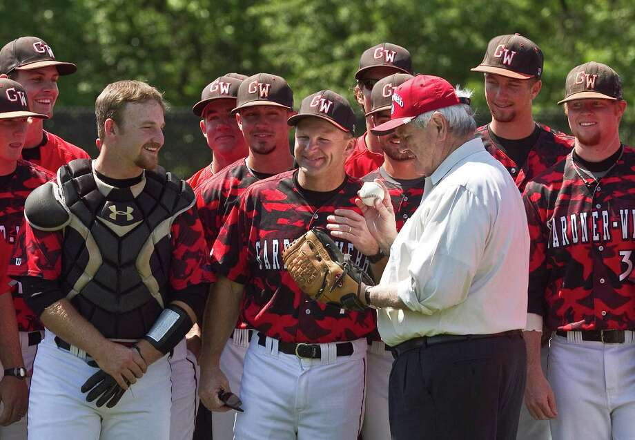 BOILING SPRINGS, NC  - APRIL 25:  Republican presidential candidate, former Speaker of the House Newt Gingrich stands with Gardner-Webb University baseball players prior to throwing out the first pitch in their game against North Carolina A&T State University while campaigning on April 25, 2012, in Boiling Springs, North Carolina. According to reports Gingrich told Republican presidential candidate and former Gov. Mitt Romney that he will bow out of the race and endorse him. Photo: John W. Adkisson, Getty Images / 2012 Getty Images