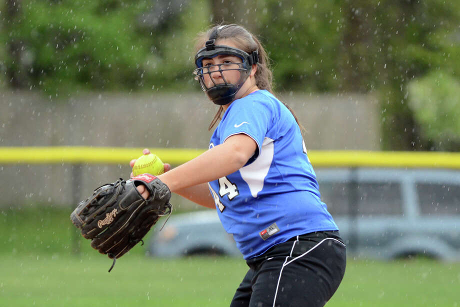 Darien's Julia Domiziano (44) throws to first during the softball game against Staples at Darien High School on Wednesday, Apr. 25, 2012. Photo: Amy Mortensen / Stamford Advocate Freelance