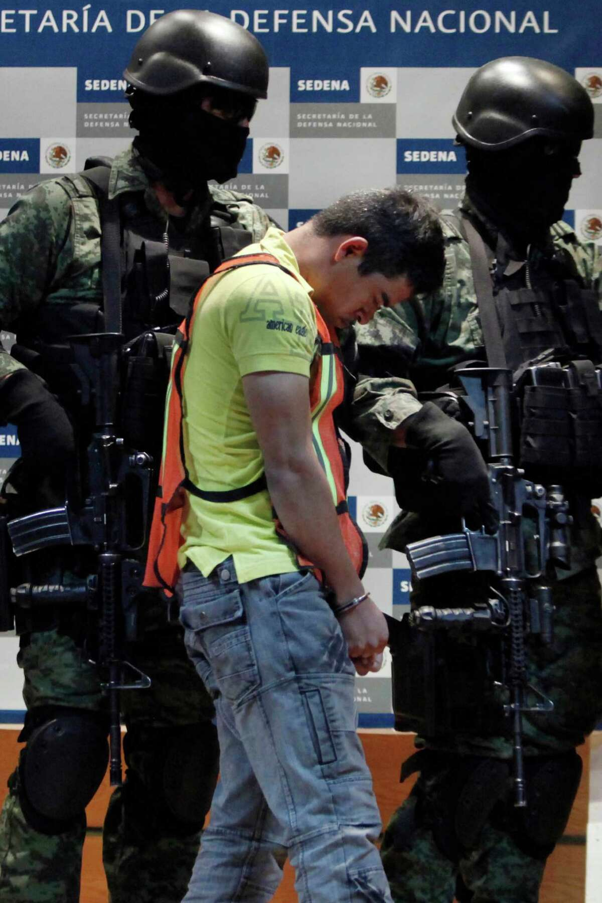 Soldiers escort Julian Zapata Espinosa, aka