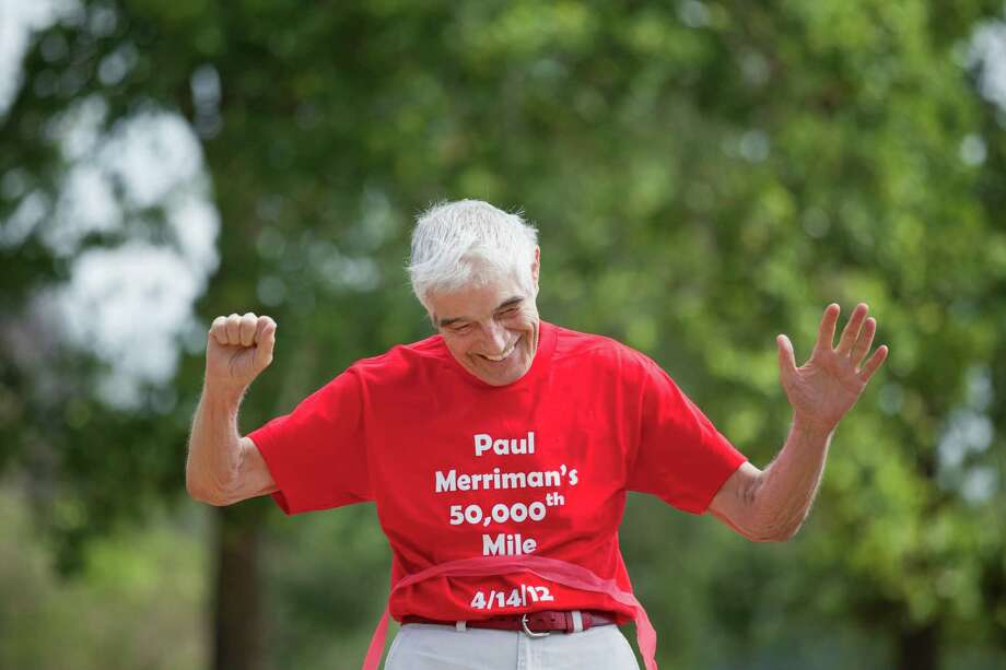 Paul Merriman dawns a smile shortly after breaking the tape, during a celebration, Saturday, April 14, 2012 at Memorial Park in Houston, Texas. 85-year-old Paul Merriman and family were in the park celebrating Merriman's 50,000th mile run. (TODD SPOTH FOR THE CHRONICLE) Photo: TODD SPOTH / © TODD SPOTH, 2012