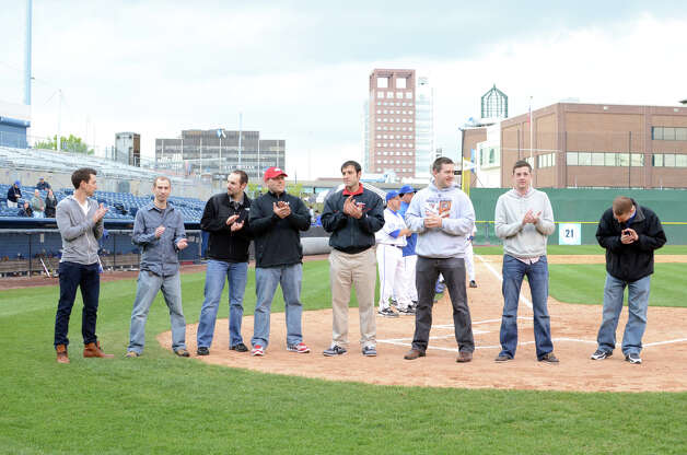 Members of the 2002 Fairfield High School baseball team congregate on the field before the Fairfield Ludlowe vs Fairfield Warde baseball game at the Ballpark at Harbor Yard in Bridgeport on Wednesday, Apr. 25, 2012. Photo: Amy Mortensen / Connecticut Post Freelance