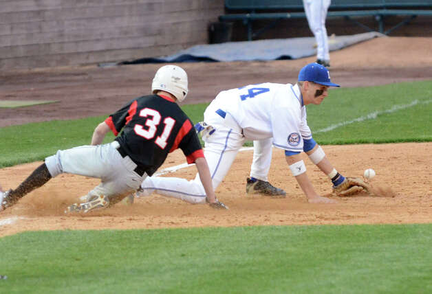 Fairfield Warde's Mike Foley (31) slides into third as Fairfield Ludlowe's Tyler Bulkley (24) recovers the ball during the baseball game at the Ballpark at Harbor Yard in Bridgeport on Wednesday, Apr. 25, 2012. Photo: Amy Mortensen / Connecticut Post Freelance
