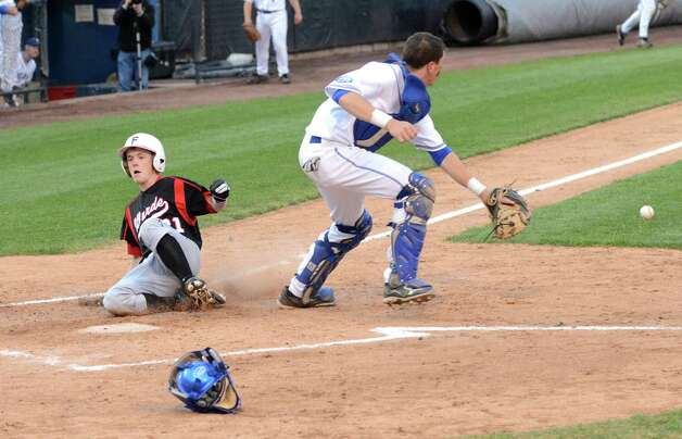 Fairfield Warde's Mike Foley (31) slides home as Fairfield Ludlowe's catcher Mike Poudrier (16) waits for the ball during the baseball game at the Ballpark at Harbor Yard in Bridgeport on Wednesday, Apr. 25, 2012. Photo: Amy Mortensen / Connecticut Post Freelance