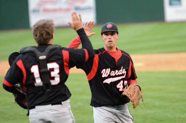 Fairfield Warde catcher Aaaron Marks (13) high fives pitcher Dan Warren (47) during the baseball game against Ludlowe at the Ballpark at Harbor Yard in Bridgeport on Wednesday, Apr. 25, 2012. Photo: Amy Mortensen / Connecticut Post Freelance