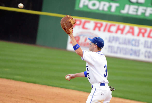 Fairfield Ludlowe's Victor D'Ascenzo (3) makes a catch between innings during the baseball game against Warde at the Ballpark at Harbor Yard in Bridgeport on Wednesday, Apr. 25, 2012. Photo: Amy Mortensen / Connecticut Post Freelance