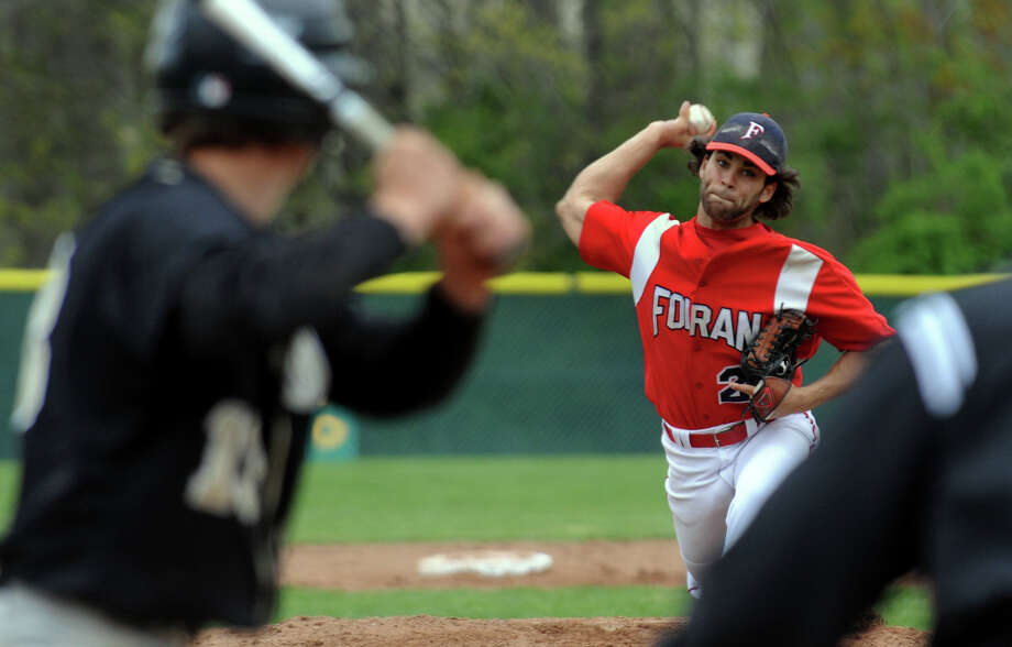Foran's Christian Malave pitches during baseball action against Jonathan Law in Milford, Conn. on Wednesday April 25, 2012. Photo: Christian Abraham / Connecticut Post