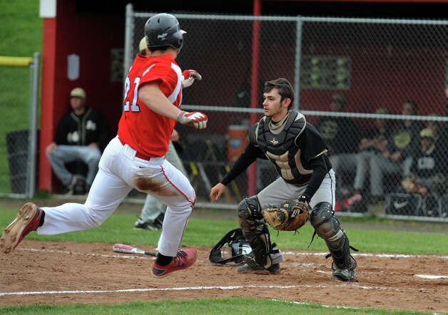 Foran's Joe Zanghi comes into home plate as Jonathan Law's Dillon Rocha waits for the ball, during baseball action against in Milford, Conn. on Wednesday April 25, 2012. Photo: Christian Abraham / Connecticut Post