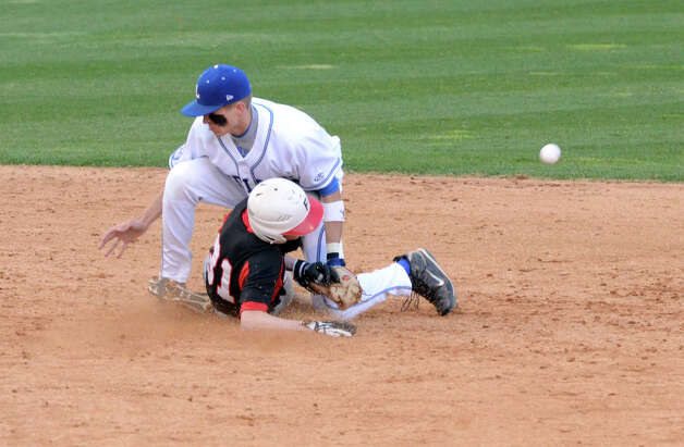 Fairfield Warde's Mike Foley (31) slides into second as the ball gets knocked loose Fairfield Luldowe's Tyler Bulkley (24) defends during the baseball game at the Ballpark at Harbor Yard in Bridgeport on Wednesday, Apr. 25, 2012. Photo: Amy Mortensen / Connecticut Post Freelance