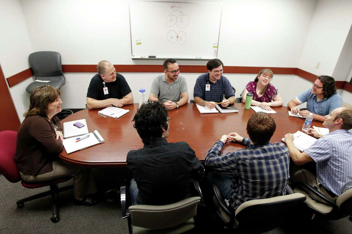 Professor Lynn Zechiedrich leads a meeting at Baylor. Her lab does basic scientific research, and she credits much of the success it has to scientists networking.