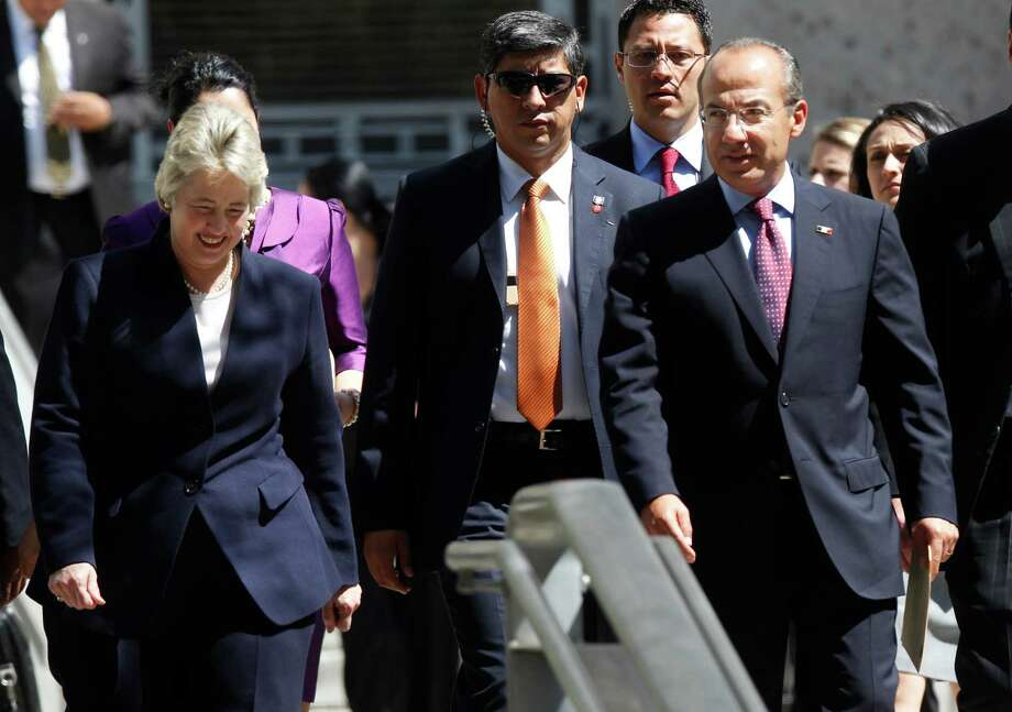 Mayor Annise D. Parker and President of Mexico Felipe Calderon walk out of City Hall after a private meeting on Wednesday, April 25, 2012, in Houston. Photo: Mayra Beltran, Houston Chronicle / © 2012 Houston Chronicle