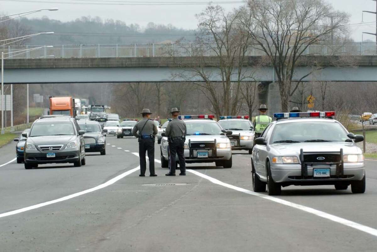 Connecticut State Troopers block the new Rt 7 bypass prior to the ribbon cutting ceremony Thursday, Nov. 19, 2009.
