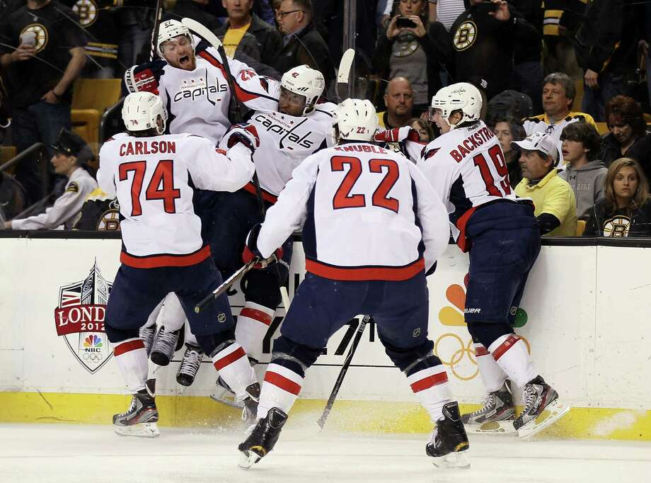 BOSTON, MA - APRIL 25:  Joel Ward #42 of the Washington Capitals is congratulated after he scored the game winning goal against the Boston Bruins in Game Seven of the Eastern Conference Quarterfinals during the 2012 NHL Stanley Cup Playoffs at TD Garden on April 25, 2012 in Boston, Massachusetts. The Washington Capitals defeated the Boston Bruins 2-1 in overtime. Photo: Elsa, Getty Images / 2012 Getty Images