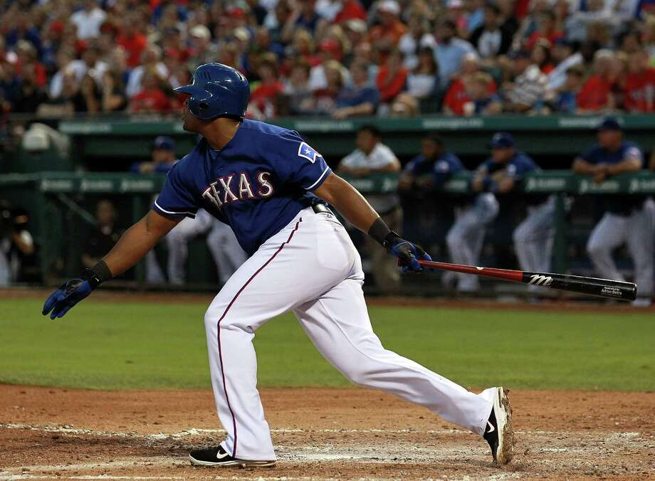 ARLINGTON, TX - APRIL 25:  Adrian Beltre #29 of the Texas Rangers hits a RBI against the New York Yankees at Rangers Ballpark in Arlington on April 25, 2012 in Arlington, Texas. Photo: Ronald Martinez, Getty Images / 2012 Getty Images