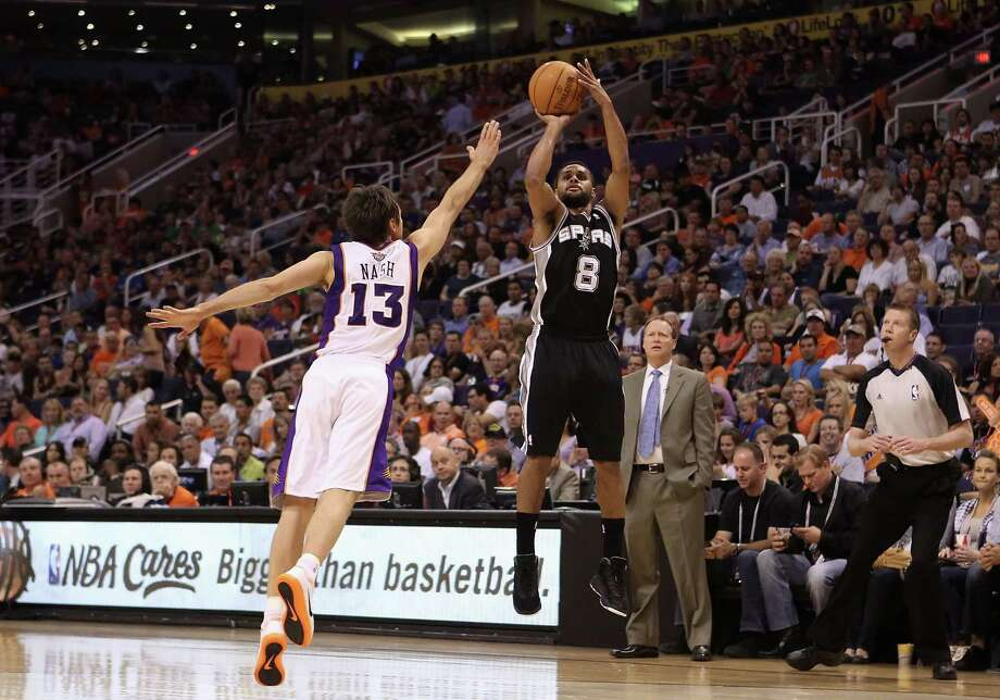 PHOENIX, AZ - APRIL 25:  Patty Mills #8 of the San Antonio Spurs puts up a shot over Steve Nash #13 of the Phoenix Suns during the NBA game at US Airways Center on April 25, 2012 in Phoenix, Arizona.  NOTE TO USER: User expressly acknowledges and agrees that, by downloading and or using this photograph, User is consenting to the terms and conditions of the Getty Images License Agreement. Photo: Christian Petersen, Getty Images / 2012 Getty Images