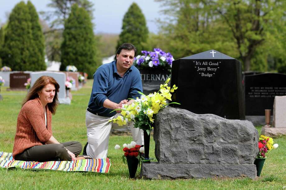 Wendy and Jerry Clark visit the gravesite of their son Jerry on Wednesday, April 25, 2012, at Calvary Cemetery in Glenmont, N.Y. Jerry Clark committed suicide on April 27, 2010 at the age of 17. (Cindy Schultz / Times Union) Photo: Cindy Schultz / 10017427A