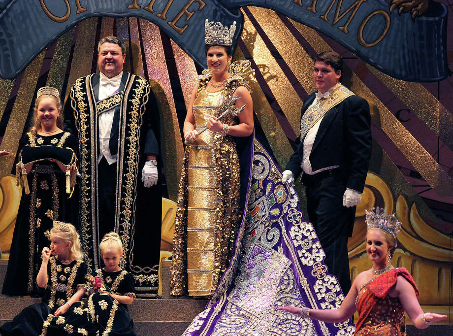 Kahler Elizabeth Biedenharn (center) is declared Queen of The Wondrous Metropolis by President of the Order of the Alamo, Stanton Paul Bell (left of Biedenharn) at the 2012 Coronation of the Order of the Alamo at the Majestic Theater on Wednesday, Apr. 25, 2012. Photo: Kin Man Hui, Kin Man Hui/Express-News / ©2012 San Antonio Express-News