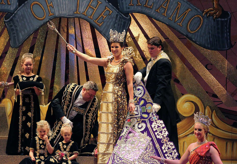 Kahler Elizabeth Biedenharn (center) waves the royal sceptre after being crowned as Queen of The Wondrous Metropolis by President of the Order of the Alamo, Stanton Paul Bell (left of Biedenharn) at the 2012 Coronation of the Order of the Alamo at the Majestic Theater on Wednesday, Apr. 25, 2012. Photo: Kin Man Hui, Kin Man Hui/Express-News / ©2012 San Antonio Express-News