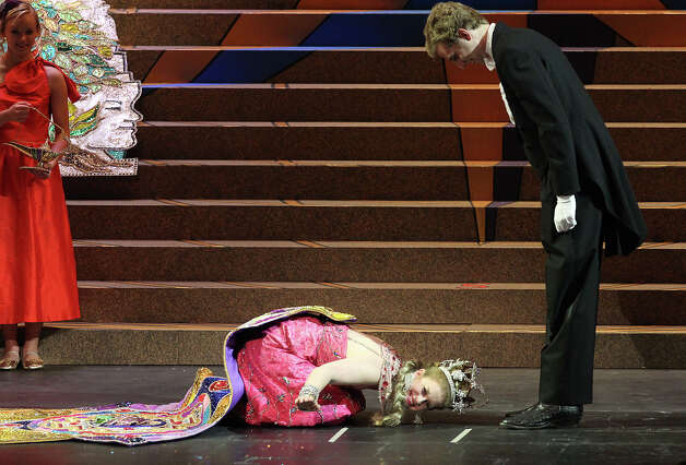 Sarah Louise Hoffman, Duchess of Romantic Realms, takes a deep bow during the 2012 Coronation of the Order of the Alamo at the Majestic Theater on Wednesday, Apr. 25, 2012. Photo: Kin Man Hui, Kin Man Hui/Express-News / ©2012 San Antonio Express-News