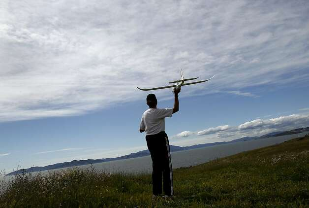 Don Cowles prepares to launch his plane off an east bay hill as storm clouds appear on the horizon. The San Francisco metropolitan area has dropped out of the 25 most polluted regions in the nation according to the American Lung Association State of the Air report Wednesday April 25, 2012. Photo: Brant Ward, The Chronicle