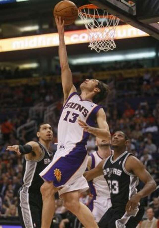 The Suns' Steve Nash scores against the Spurs during the second half  Wednesday, April 25, 2012, in Phoenix. (AP Photo/Matt York) (AP)