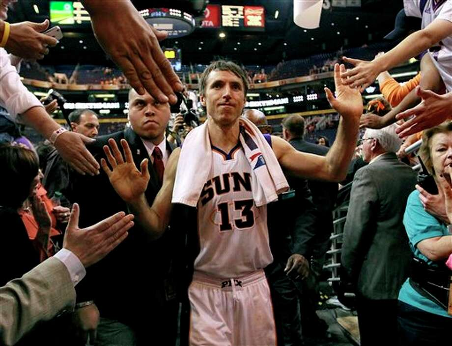 The Suns' Steve Nash leaves the court  after Wednesday's game against the Spurs in Phoenix. This could be Nash's final game for the Suns. The two-time MVP and eight-time All-Star will become a free agent this summer and is seeking a three-year deal. (AP Photo/Matt York) Photo: Matt York, AP / AP
