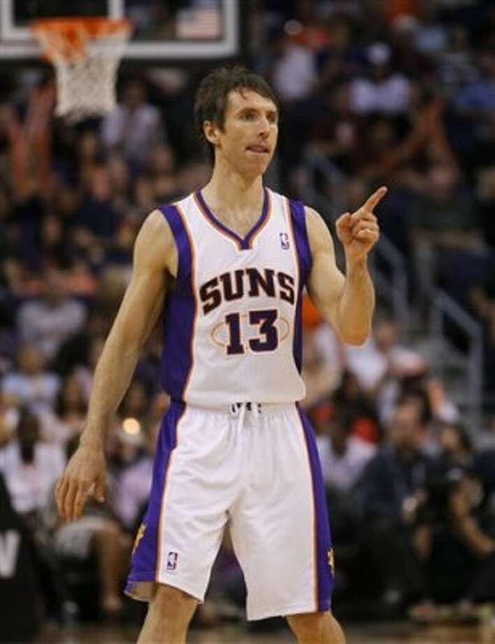 Phoenix Suns' Steve Nash points to a teammate after scoring against the Spurs during the second half   Wednesday, April 25, 2012, in Phoenix. (AP Photo/Matt York) (AP)