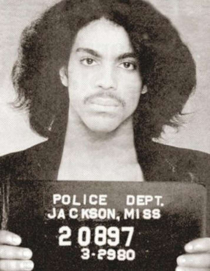 "Prince (1980): The Great Purple One was arrested in Mississippi for ""pulling a prank"" on an airplane. So that's what they called it back then."