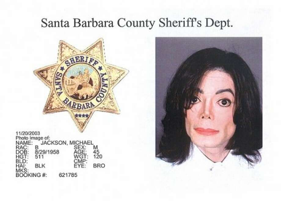 Michael Jackson (2003): Posing at the Santa Barbara County Sheriff's office following his arrest for child molestation.