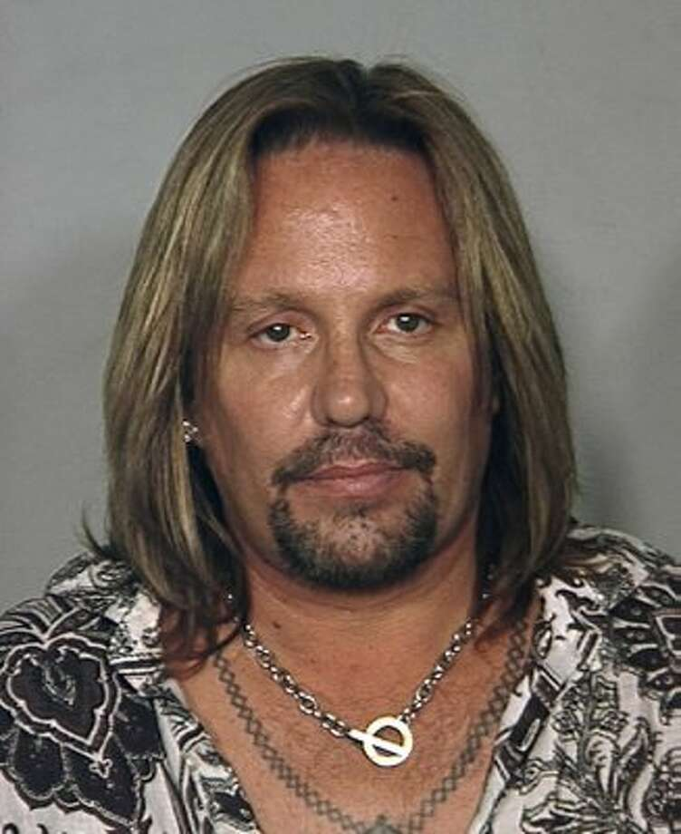 Vince Neil of Motley Crue (2010): Charged with drunk driving in Las Vegas. This shot is most notable for including his real necklace and tattoo necklace.