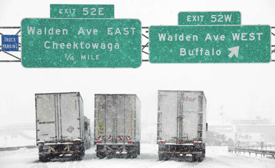 Vehicles sit stranded on the New York State Thruway during a winter storm in Buffalo, N.Y., Thursday, Dec. 2, 2010. Photo: David Duprey, AP / AP