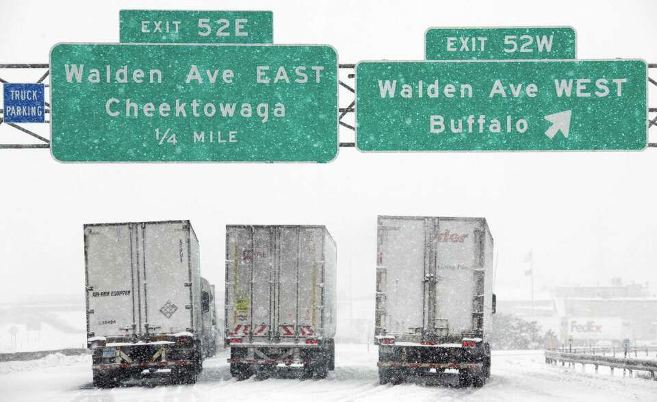 Vehicles sit stranded on the New York State Thruway during a winter storm in Buffalo, N.Y., Thursday