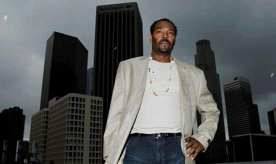 On April 13, 2012, Rodney King poses for a portrait in Los Angeles. The acquittal of four police officers in the videotaped beating of King sparked rioting that spread across the city and into neighboring suburbs. Cars were demolished and homes and businesses were burned. Before order was restored, 55 people were dead, 2,300 injured and more than 1,500 buildings were damaged or destroyed.(AP Photo/Matt Sayles) Photo: Matt Sayles