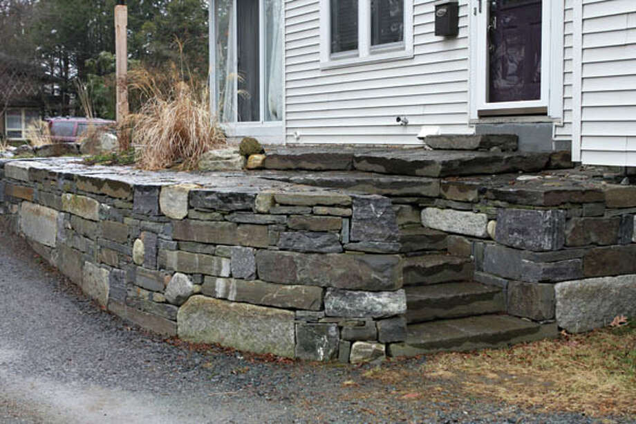 """Altamont-based Warren """"Roy"""" Melby, aka the Zen Stoneguy, believes that stone has a life of its own. He uses this philosophy to drive the organic, sculptor's-eye sensibility of his masonry. Read the story here. Photo: Krishna Hill/Life@Home"""