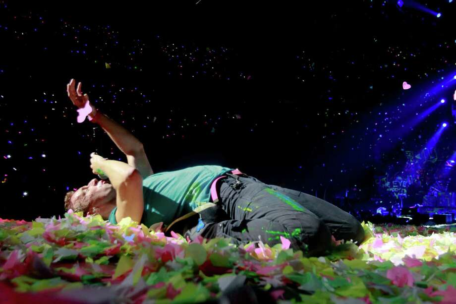 Coldplay vocalist Chris Martin performs live on a confetti-covered stage at KeyArena on Wednesday. Photo: Sofia Jaramillo / SEATTLEPI.COM