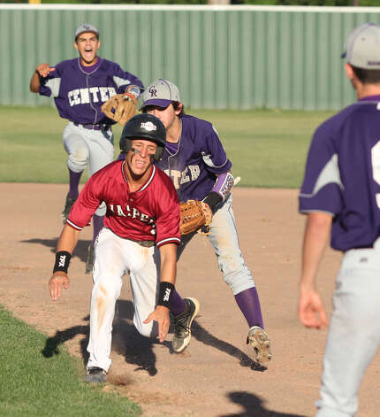 Jessie Due is tagged out during a rundown against Center. Photo: Jason Dunn