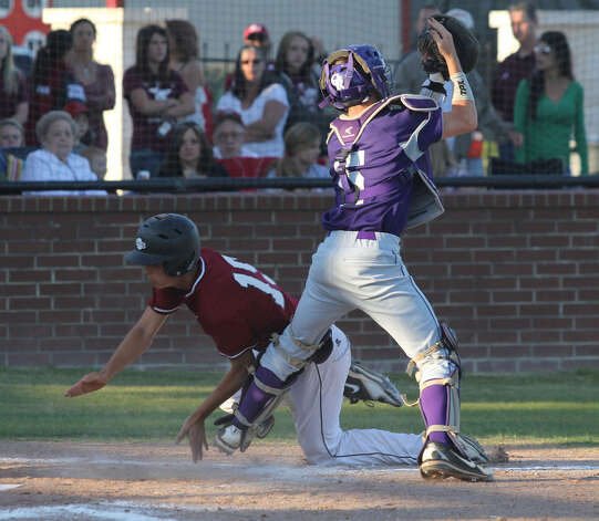 Jasper's Jake Dufner tries to score around Center's catcher at a play at the plate. Photo: Jason Dunn