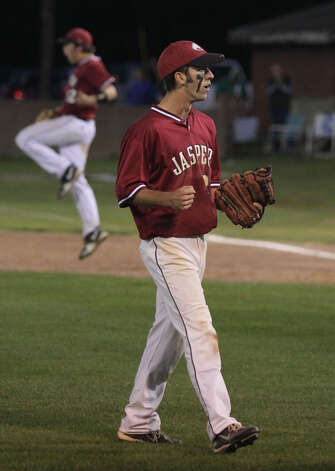 Tyler Bolton reacts as the last out is recorded against Center as Clayton Hart celebrates in background. Photo: Jason Dunn