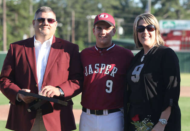 Senior Jacob Clark and his parents. Photo: Jason Dunn