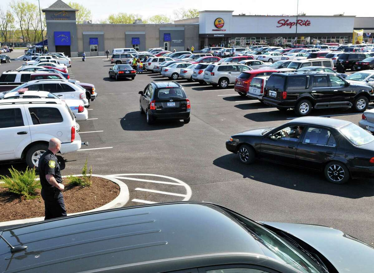 Albany Police Officer Greg Whitney on Thursday directs traffic entering the parking lot of the new ShopRite supermarket on Central Avenue in Albany. (John Carl D'Annibale / Times Union)