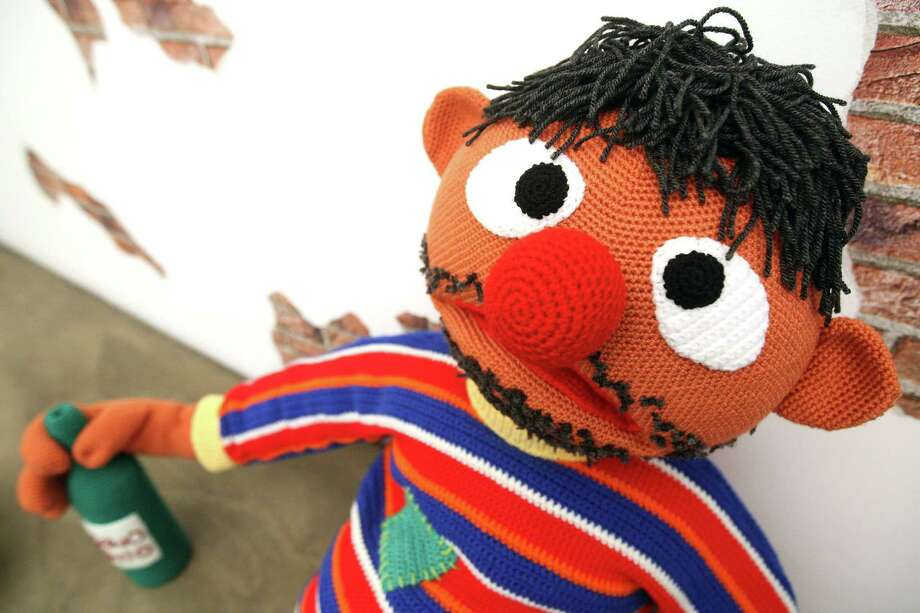 "The knitted sculpture ""Ernie"" by Patricia Waller, featuring the children's television program star as a desperate alcoholic, sits in the ""Broken Heroes"" exhibition at the Deschler Gallery on April 26, 2012 in Berlin, Germany. The exhibition of hand-crocheted comic, puppet and cartoon figures shows icons of pop culture in various unfortunate states. Photo: Adam Berry, Getty Images / 2012 Getty Images"