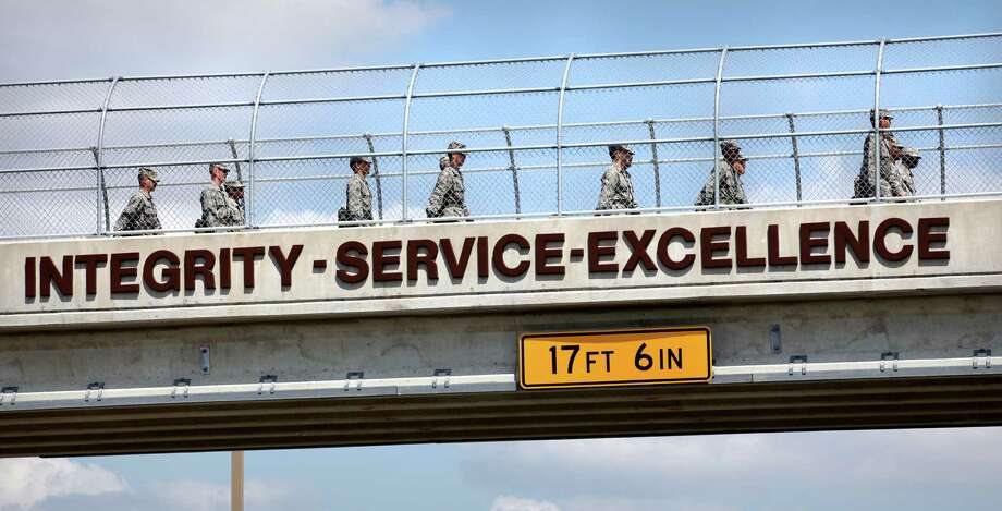Lackland AFB trainees walk across a pedestrian overpass sporting the three core values. Ret. Gen. Ronald Fogleman created the ethos in the wake of scandals in the 1990s. Photo: BOB OWEN, San Antonio Express-News / © 2012 San Antonio Express-News