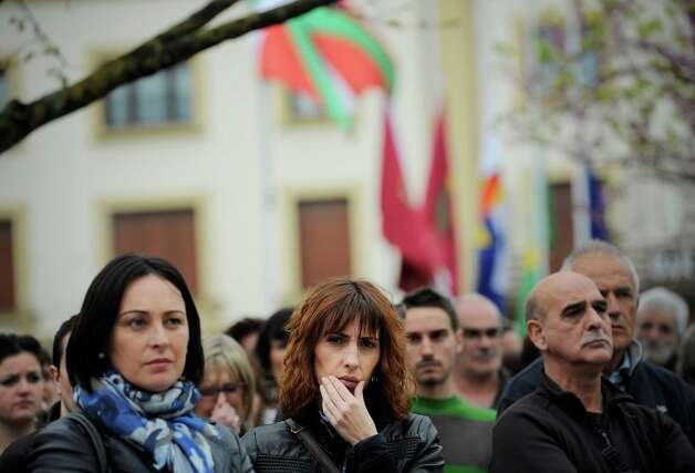 People stand in silence remembering those who died in Guernica, northern Spain, on the anniversary of the attack, Thursday April 26, 2012. The small Basque town was razed by a German bomber attack and some thousands of Basque citizens lost their lives on this day in 1937. The carnage has ever since stood as a symbol of man's cruelty to his fellow man, immortalized in Pablo Picasso's immense and powerful painting, one of the most iconic works of art of the 20th century. Photo: Alvaro Barrientos, AP / AP