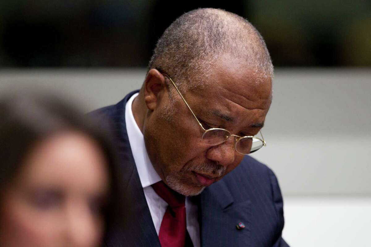 Former Liberian President Charles Taylor looks down as he waits for the start of a hearing to deliver verdict in the court room of the Special Court for Sierra Leone in Leidschendam, near The Hague, Netherlands, Thursday. He was convicted of arming notoriously brutal rebels in neighboring Sierra Leone.