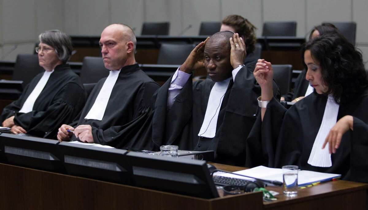 The prosecution with Brenda J. Hollis, Nicholas Koumjian and Mohammed Bangura, from left to right, wait for the start of a hearing to deliver verdict in the case against Former Liberian President Charles Taylor in the court room of the Special Court for Sierra Leone in Leidschendam, near The Hague, Netherlands, Thursday Judges convicted Taylor of supporting notoriously brutal rebels in neighboring Sierra Leone.