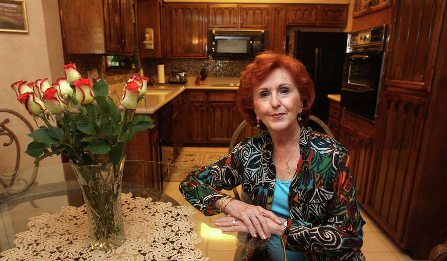 Rose Mary Zepeda has made numerous improvements throughout her kitchen over the years like a tile backsplash, a glass table to dine on and plantation shutters in the windows. (Friday April 20, 2012) John Davenport/San Antonio Express-News Photo: JOHN DAVENPORT, SAN ANTONIO EXPRESS-NEWS / SAN ANTONIO EXPRESS-NEWS (Photo can be sold to the public)