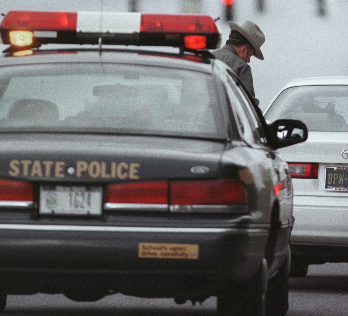 OCT. 29,1998 - LATHAM, NY -- TROOPER MIKE ANSON PREPARES TO ISSUE A TRAFFIC SUMMONS TO A DRIVER ON I87 DURING A BLANKET PATROL FOR AGGRESSIVE DRIVING, OTHERWISE KNOWN AS ROAD RAGE,