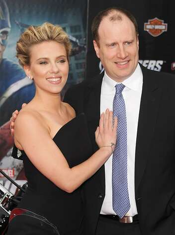 "HOLLYWOOD, CA - APRIL 11:  Actress Scarlett Johansson (L) and producer Kevin Feige arrive at the premiere of Marvel Studios' ""The Avengers"" at the El Capitan Theatre on April 11, 2012 in Hollywood, California.  (Photo by Kevin Winter/Getty Images) Photo: Kevin Winter, Getty Images"